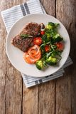 Delicious juicy barbequed steak and prawns with vegetable salad stock photo