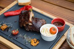 BBQ pork ribs with Coleslaw salad and BBQ sauce ribs royalty free stock image