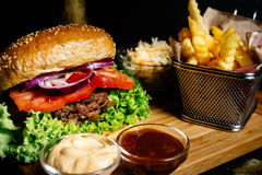 delicious juicy beef burger, american style food with french fries and coleslaw salad stock photo