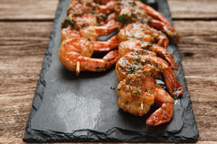Delicious juicy fried prawns served on black slate. Japanese cuisine. Fried shrimps served on black slate, close up view. Restaurant menu photo, free space for Royalty Free Stock Images