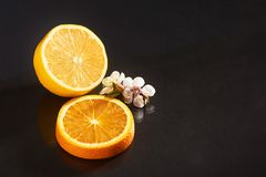 Delicious and juicy orange and lemon isolated on a black background. Royalty Free Stock Photo