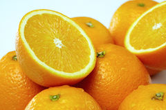 Delicious and juicy oranges on white background Stock Photos