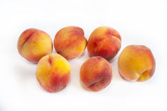 Delicious, juicy peaches on a white background Stock Photography