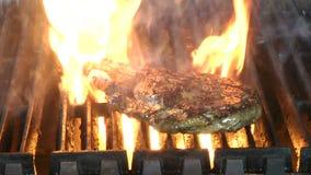 Delicious juicy rib eye steak on a grill