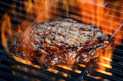 Delicious juicy rib eye steak on the grill Stock Photo