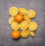 Delicious, juicy, ripe oranges, sliced  granite rustic background top view close up Stock Photo