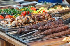 Delicious kebab on a skewer on the counter Stock Photos