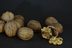 Delicious kernel of walnut on a chopped shell. Around whole nuts. Healthy eating, good for the brain royalty free stock photography