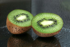 Delicious kiwi fruit on the mirror Royalty Free Stock Photography