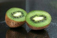 Delicious kiwi fruit on the mirror Royalty Free Stock Photography