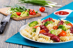 Delicious l Pasta salad with  broccol, tomatoi and grilled sausa Royalty Free Stock Photography