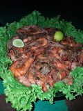 Delicious large shrimp with spices and garnish stock image