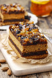Delicious layer gingerbread cake decorated with dried fruits Royalty Free Stock Photos