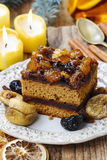 Delicious layer gingerbread cake decorated with dried fruits Stock Images