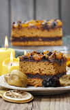 Delicious layer gingerbread cake decorated with dried fruits Royalty Free Stock Images