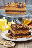 Delicious layer gingerbread cake decorated with dried fruits Stock Photo