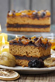 Delicious layer gingerbread cake decorated with dried fruits Royalty Free Stock Photo