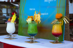 Delicious layered alcoholic cocktails in glasses, decorated with Royalty Free Stock Images