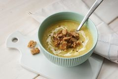 Leek cream soup in a bowl. Delicious leek cream soup with dry bread Stock Photography