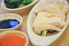 Delicious legendary Singaporean Hainanese chicken rice with two. Delicious legendary Singaporean Hainanese traditional cooking style for chicken rice with two Royalty Free Stock Image
