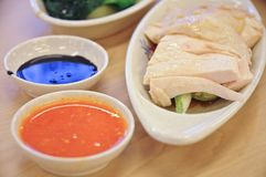 Delicious legendary Singaporean Hainanese chicken rice with two. Tones dipping sauce in Singapore Stock Image