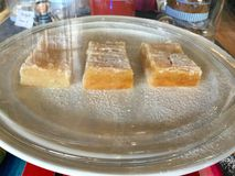 """Delicious Lemon. Dessert bars, or simply bars or squares, are a type of American """"bar cookie"""" that has the texture of a firm cake or softer than usual royalty free stock image"""