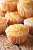 Delicious lemon muffins with icing and zest macro. vertical Royalty Free Stock Image