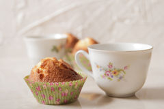 Delicious lemon muffins with tea and coffee. Romantic mood royalty free stock photography