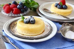 Delicious lemon pudding cake served with berries Stock Photography