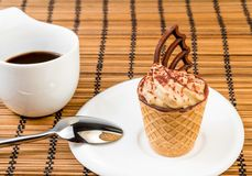 Delicious little coffee cake with chocolate near a cup of coffee Stock Photography