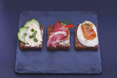 Delicious little sandwiches with tuna, cheese, prosciutto and ve Royalty Free Stock Images