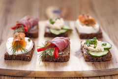 Delicious little sandwiches with tuna, cheese, prosciutto and ve Royalty Free Stock Image