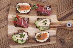 Delicious little sandwiches with tuna, cheese, prosciutto and ve Stock Photo
