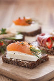 Delicious little sandwiches with tuna, cheese, prosciutto and ve Stock Photography