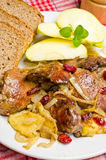 Delicious livers with apple and cranberries Royalty Free Stock Photo