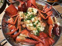 Delicious lobster cooked in the pot. Red lobster cooked with delicious taste Royalty Free Stock Photography