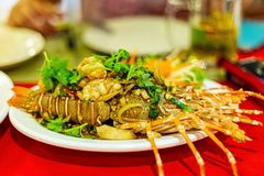 Delicious lobster stuffed grilled garlic sauce with herbs appetizing exotic dish close-up marine delicacies asia royalty free stock photography