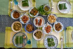 Delicious local Northern Thai style food including spicy sausage, fried pork, pork rinds, chilli paste and vegetable, curry, other Stock Photography
