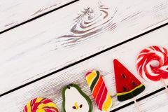 Delicious lollipops on wooden background. royalty free stock photography