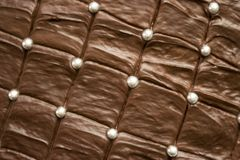 Delicious looking brown chocolate cake with silver sugar balls stock images