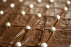 Delicious looking brown chocolate cake with silver sugar balls. Simple and nice-looking picture of a delicious looking brown chocolate cake with silver sugar stock photo