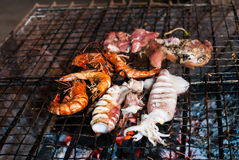 Delicious looking shrimp and squid on the grill Royalty Free Stock Photography