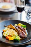 Delicious lunch or dinner. With lamb cutlets and red wine in a restaurant Royalty Free Stock Images