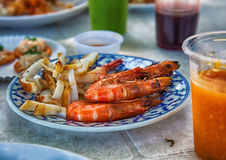 Delicious lunch: fried seafood, natural juices, chicken. Summer cafe Stock Photos