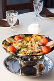 A delicious lunch of potatoes, meat, tomatoes Royalty Free Stock Photography
