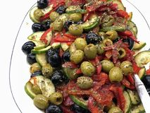 Delicious and luxury aperitif with fresh roasted vegetables with olives and herbs royalty free stock photography
