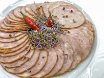 Delicious and luxury aperitif with fresh slices of salami and herbs stock photo