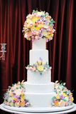Delicious luxury white wedding cake decorated with cream flowers