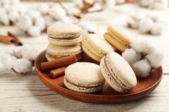 Free Delicious Macarons And Cotton Flowers On White Wooden Table Royalty Free Stock Images - 220547199