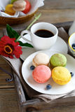 Delicious macaroon on a plate with coffee Royalty Free Stock Photo